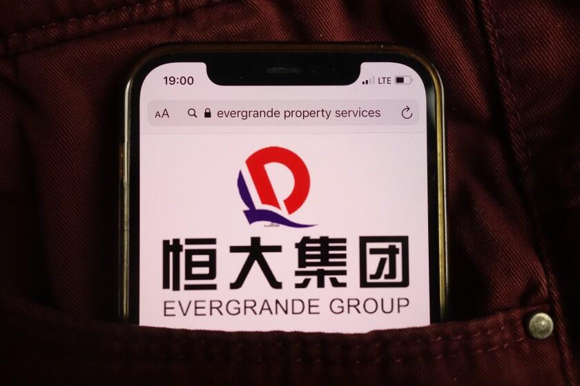 KONSKIE, POLAND - August 17, 2021: Evergrande Group logo on mobile phone hidden in jeans pocket