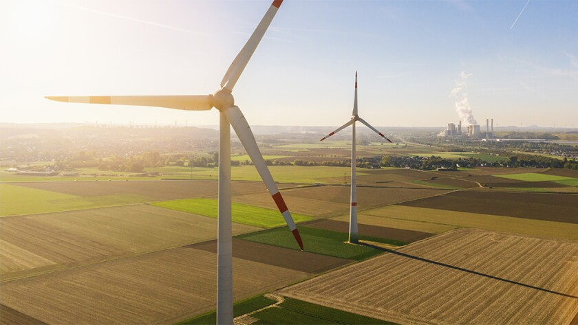 Wind turbine with coal power plant view from drone.jpg