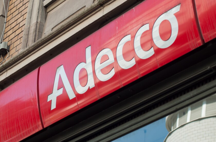Mulhouse- France - 31 August 2019 - Closeup of Adecco sign on building facade, Adecco is the famous french Temporary work agency