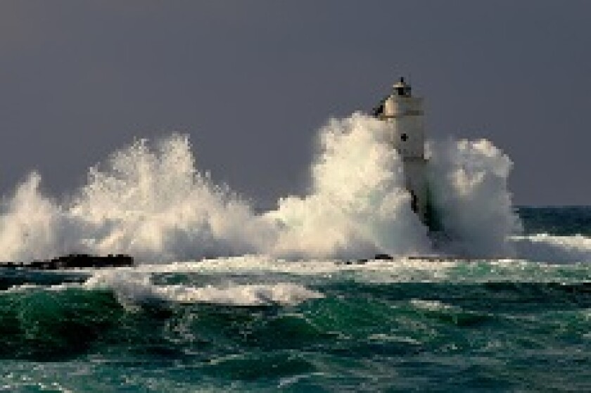 Lighthouse in storm from alamy 230x150