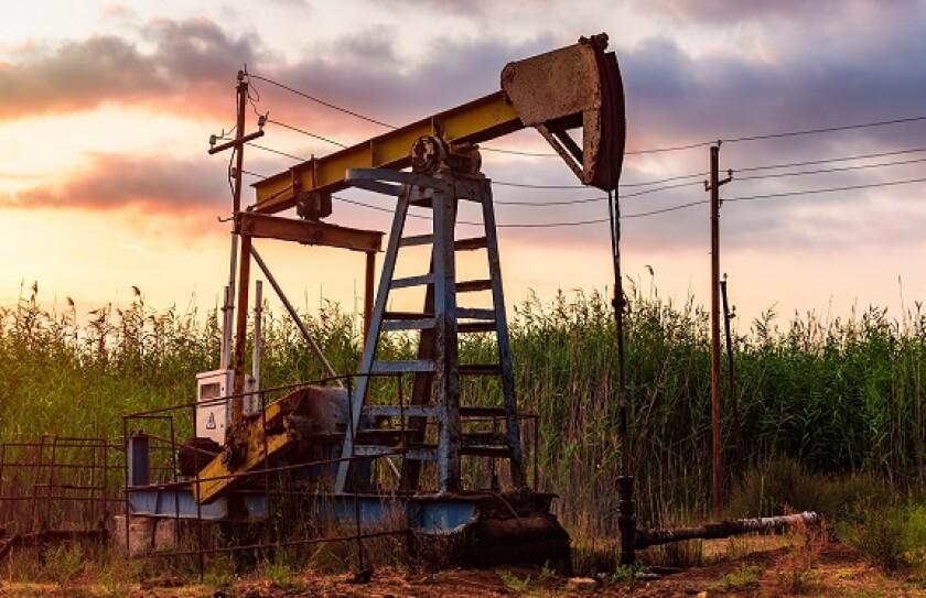 Rusty oil derrick fossil fuel from Adobe 30Oct20 575x375