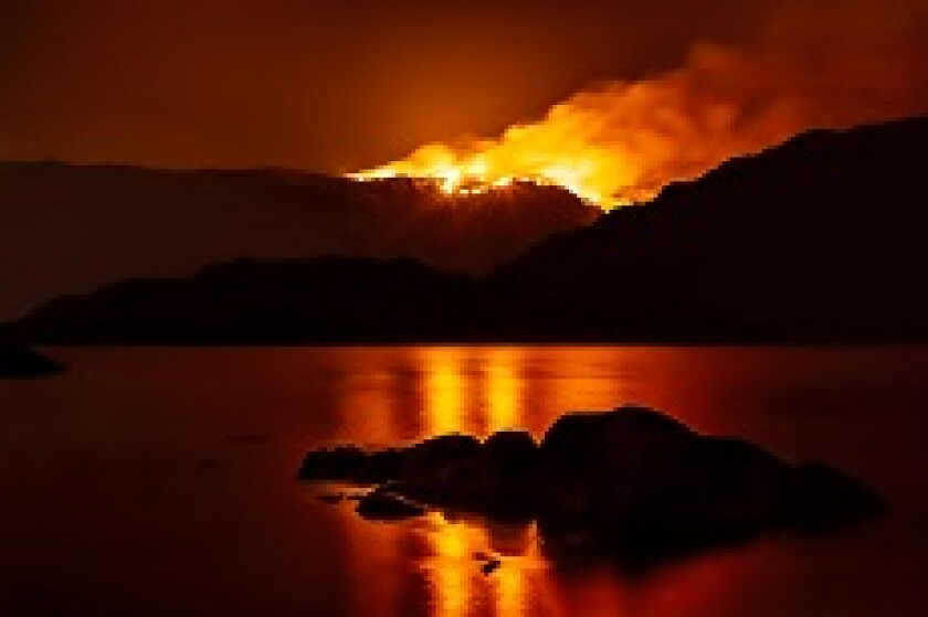 California forest fire lake at night global warming from Adobe 230x150
