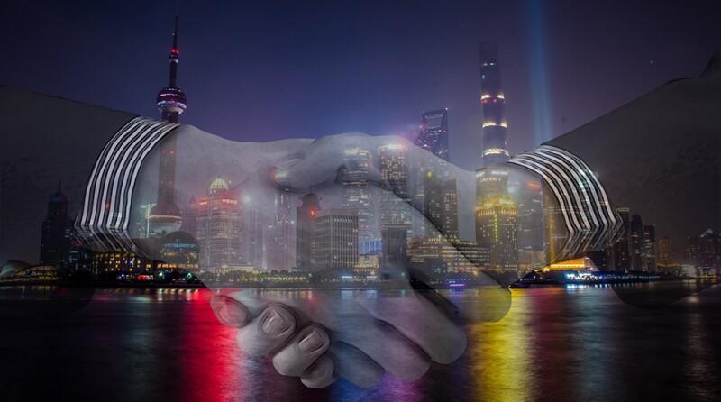 Shanghai_handshake-960x535.jpg