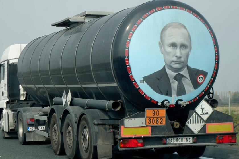 A large tank truck (Serbian licence plate) with image of Vladimir Putin on its rear, drives along the high way through Croatia.