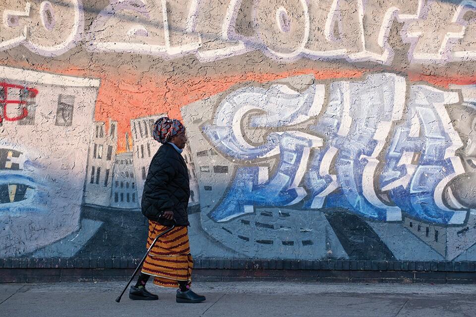 woman-walking-graffiti-Reuters-960.jpg