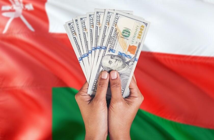 AdobeStock_Oman_dollars_575x375_10March2021