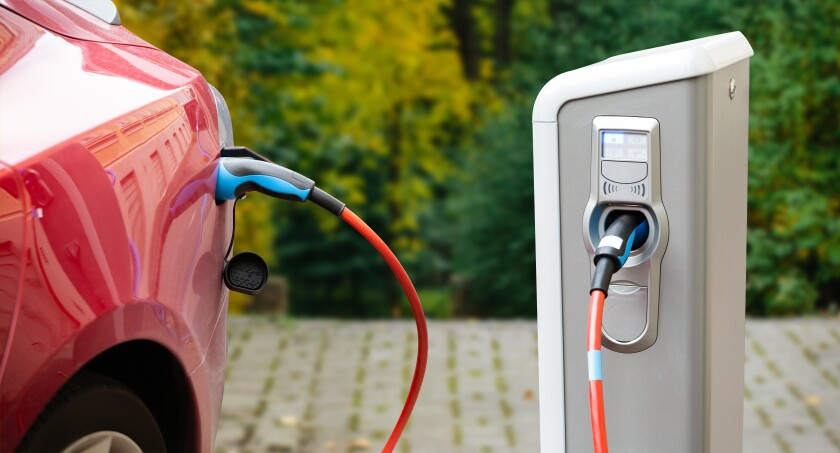 Close up of a charging electric car