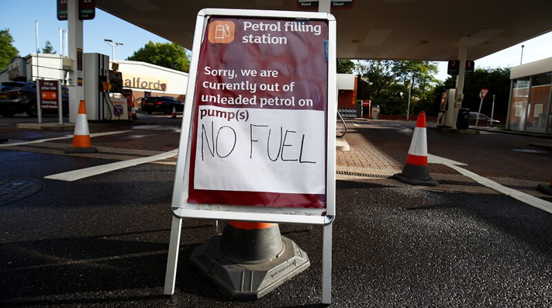 A sign informs customers that fuel has run out at a petrol station in Northwich