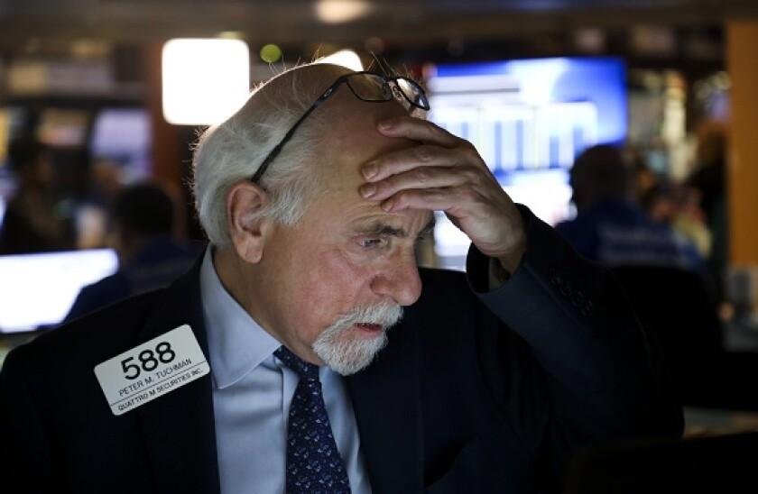 Trader_NYSE_PA_12March_2020_575x375.jpg