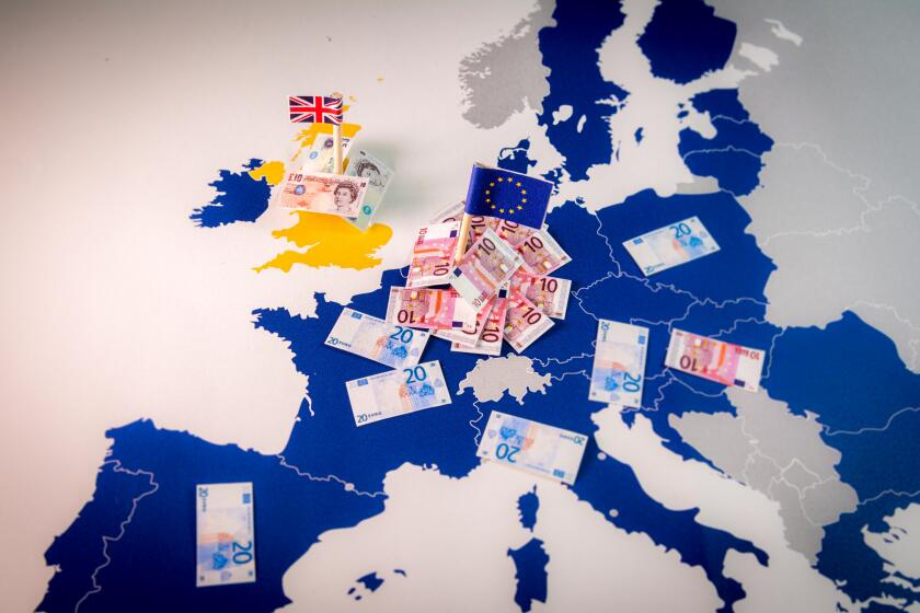 EU and UK flags,euro and pound bills on a european map with EU members in blue.Suitable for a concept of BREXIT,pound against euro,London or Frankfurt