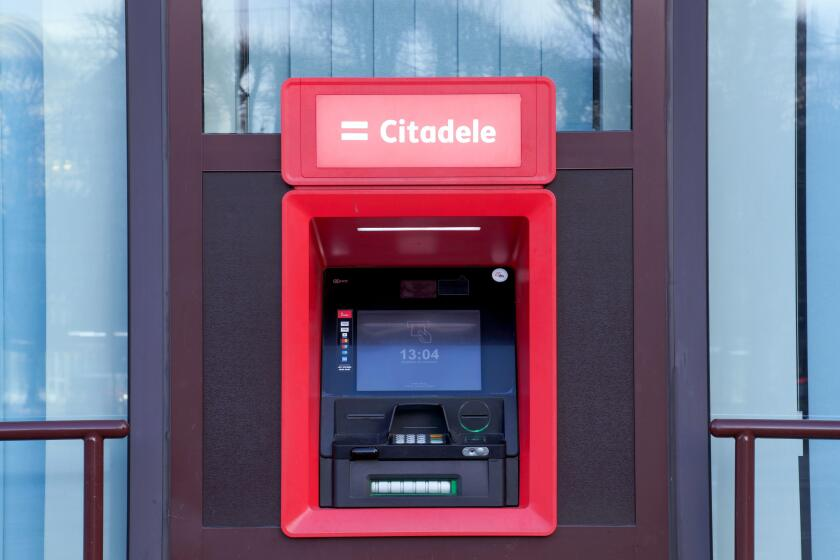 Riga, Latvia - November 30, 2019 : Citadele ATM, electronic banking outlet that allows customers to complete basic transactions, Latvian bank and fina