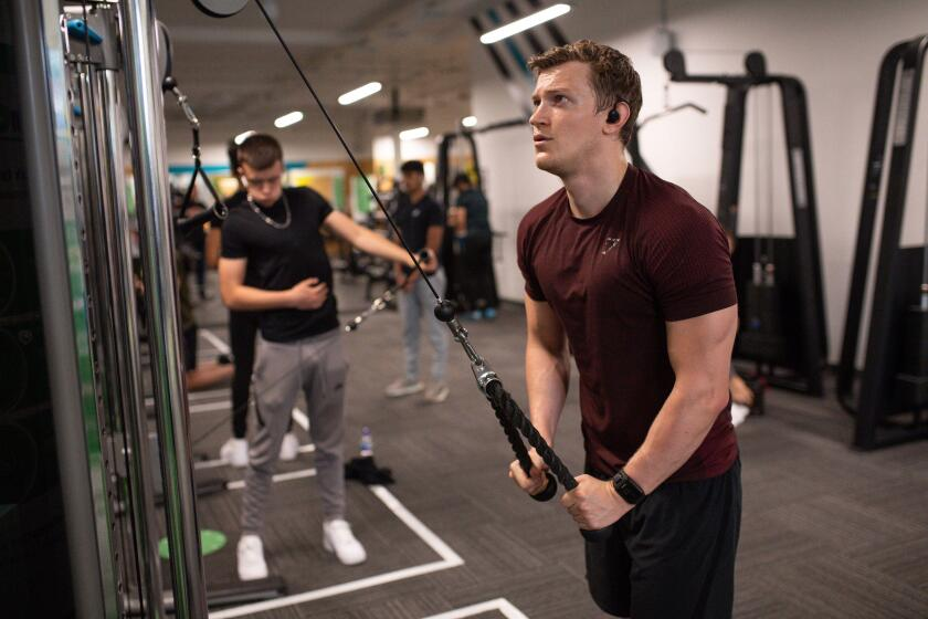 Gym members exercise at PureGym in Leamington Spa, which is re-opening as indoor gyms, swimming pools and sports facilities can reopen as part of the latest easing of coronavirus lockdown measures in England.