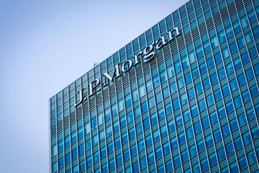 Logo sign of JP Morgan Bank on side of their European Headquarters office building in Canary Wharf, Docklands, London