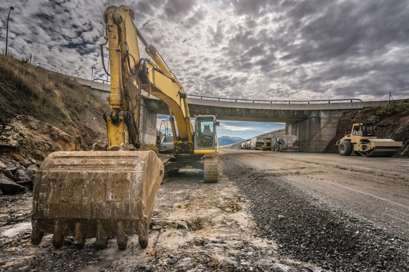 Excavator in the construction of a highway