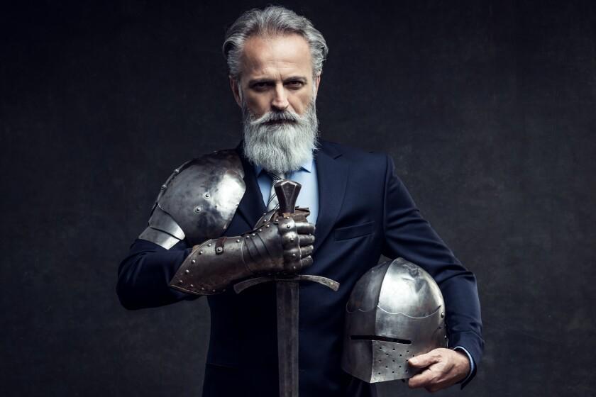 Classy dressed senior businessman with knight sword