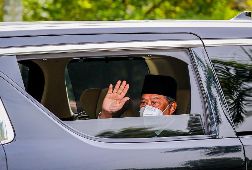 Kuala Lumpur, Malaysia. 04th Aug, 2021. Malaysia's Prime Minister Muhyiddin Yassin waves at the media as he arrives at the National Palace for an audience with King Al-Sultan Abdullah Ri'ayatuddin Al-Mustafa Billah Shah in Kuala Lumpur. United Malays Nati