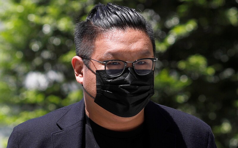 Ng Yu Zhi, a director of Envy Global Trading, arrives at the State Court in Singapore in April