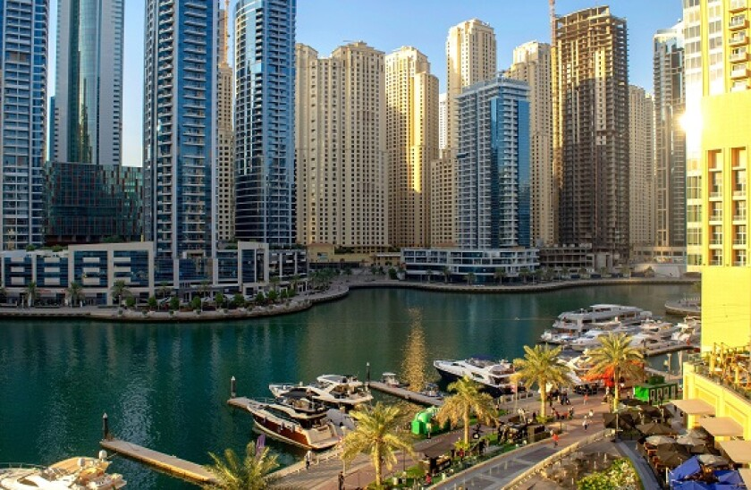 Dubai  UAE - September 26, 2020: Beautiful view of Dubai Marina promenade and river from Marina Mall with many people before the sunset