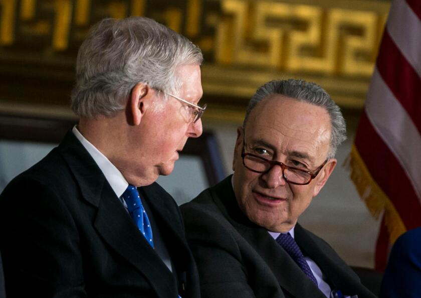 Senate Majority Leader Mitch McConnell, a Republican from Kentucky, and Senate Minority Leader Chuck Schumer, a Democrat from New York, speak during a congressional Gold Medal ceremony for former Senator Bob Dole, in Washington D.C., U.S., on Wednesday, J