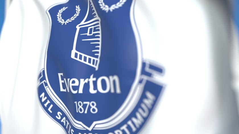 Flying flag with Everton FC football club logo, close-up. Editorial 3D rendering