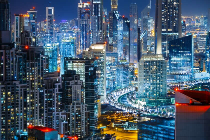 Rooftop view a big modern city by night. Travel background.