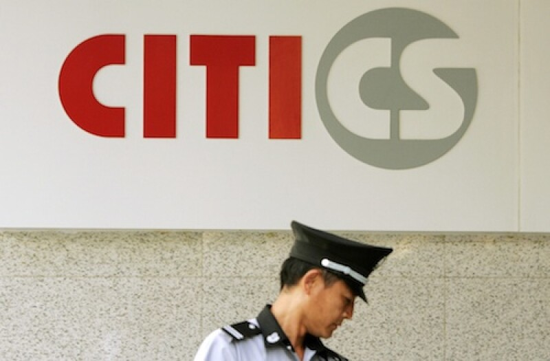 A security guard is seen under the logo of CITIC Securities at a branch of the security brokerage house in Shanghai