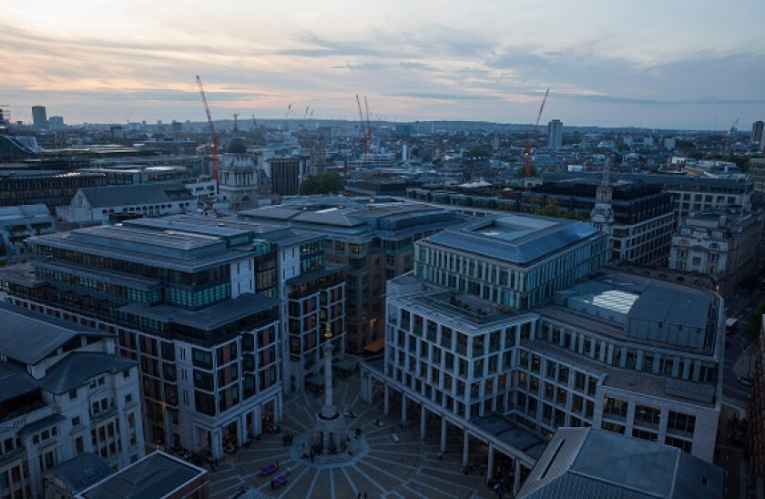 Paternoster Square in London, England, as seen from the top of St. Paul's Cathedral at dusk.
