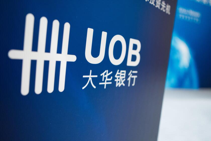 --FILE--View of an advertisement for Singapore-based United Overseas Bank (UOB) in Shanghai, China, 8 April 2013.   United Overseas Bank (China) Ltd.