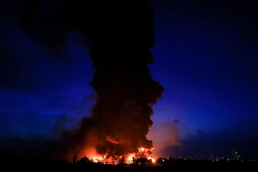 Indramayu, Indonesia. 29th Mar, 2021. Smokes and massive fire rise from an oil refinery of state-owned oil and gas company PT Pertamina at Balongan, Indramayu, West Java, Indonesia, on March 29, 2021. Three people went missing and 19 others were wounded w