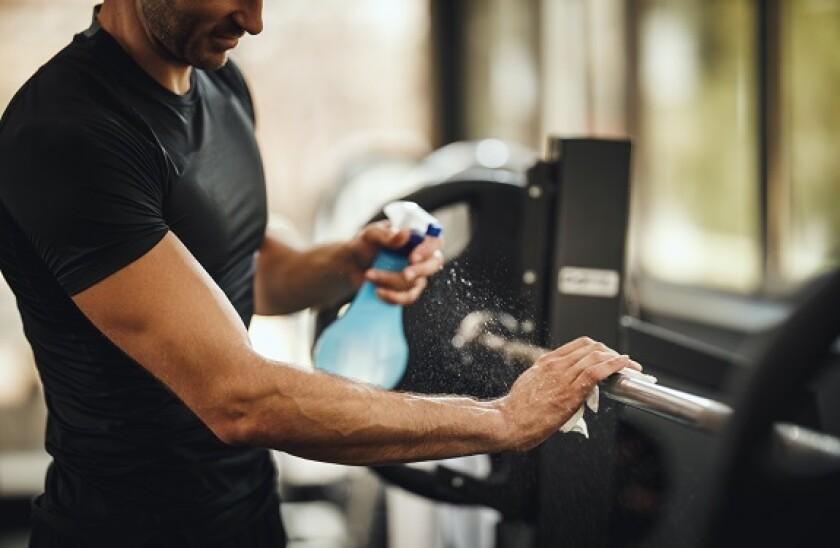 gym wiping adobe stock 575 375