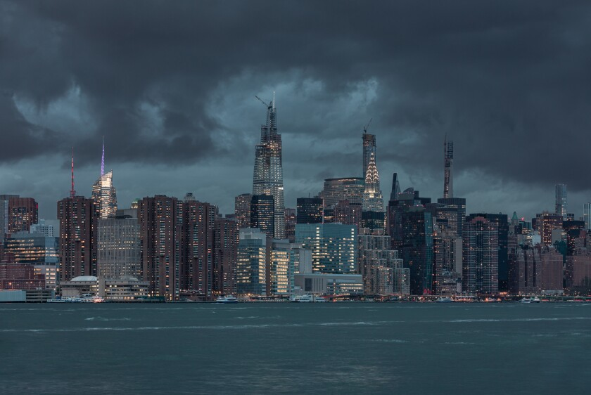 NYC Cityscape with Stormy Cloudy Blue Sky in Background