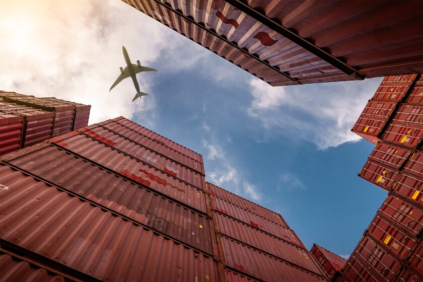 Airplane flying above container logistic Cargo and shipping business Container ship .jpg