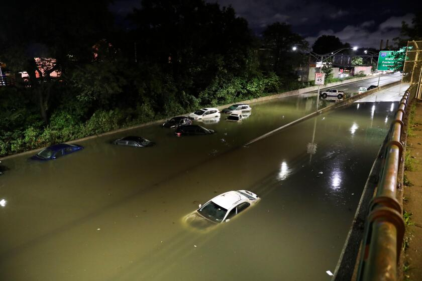 New York, USA. 2nd Sep, 2021. Vehicles are submerged on a waterlogged road in New York, the United States, Sept. 2, 2021. New York State Governor Kathy Hochul declared her first state of emergency early Thursday as remnants of Hurricane Ida brought torren