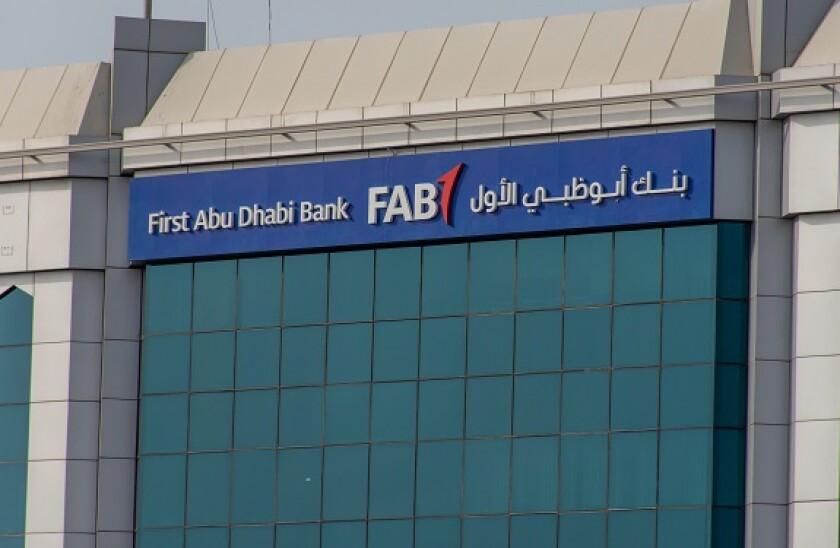 """Ras al Khaimah, Ras al Khaimah/United Arab Emirates - 7/4/2019: ""First Abu Dhabi (FAB) Bank blue storefront on a blue sky sunny day. """