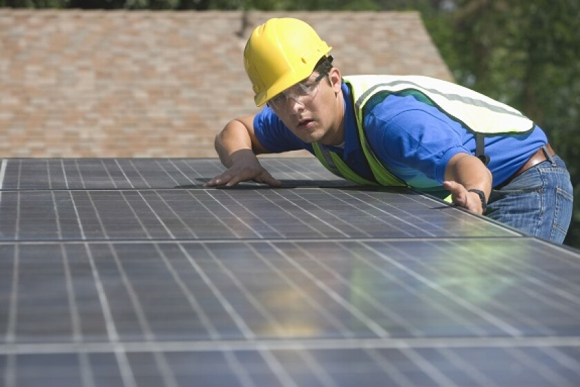 Installing solar panel rooftop from Adobe 9Jul20 575x375